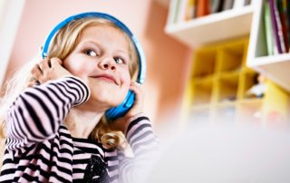 A girl listening to music in her headphones.