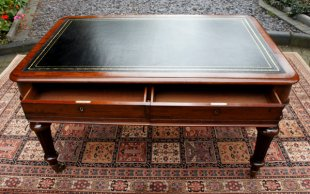 Antique Writing Table with leather writing surface.