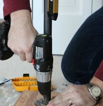 Attaching the pipe legs to a butcher block table top