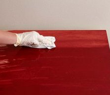 Wiping Away Excess Desk Stain